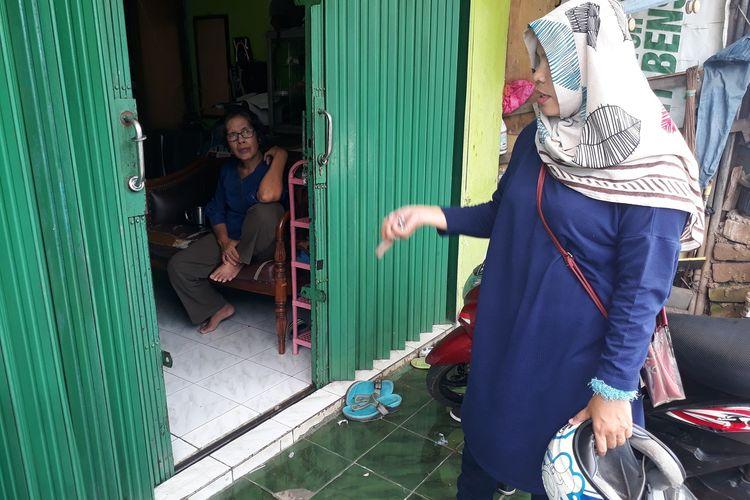 Natalina Hasugian, tante dari A, bayi yang hampir diculik pria bernama Ryan di halaman rumahnya, Jalan Raya Malaka, Cipayung, Jakarta Timur, Selasa (28/1/2020).