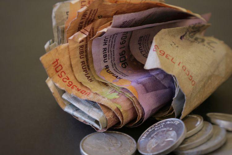Ilustrasi uang rupiah dalam jumlah tak banyak.