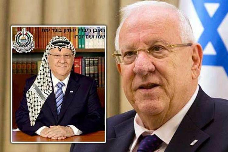 Gambar Presiden Israel, Reuven Rivlin, yang kontroversial karena mengenakan penutup kepala Palestina