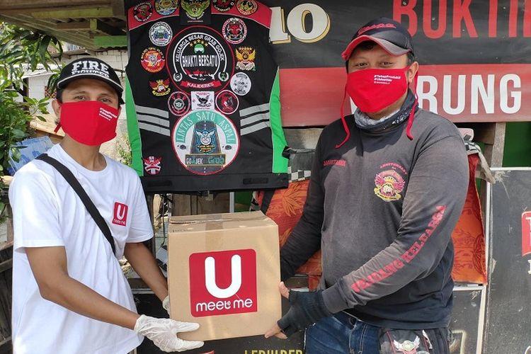 UMeetMe dalam gerakkan #TetapBerbagi membagikan 10.000 masker kepada pengemudi ojek, pedagang, dan pemulung, Rabu (29/4/2020)-Jumat (1/5/2020).
