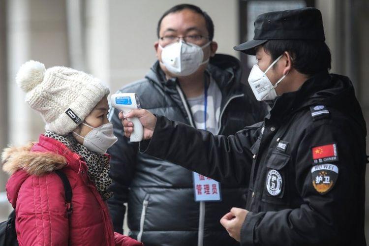 Dampak Virus Corona, sejumlah petugas melakukan pemeriksaan ketat di sejumlah wilayah di China
