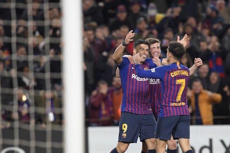 Philippe Coutinho merayakan gol bersama rekan-rekannya pada pertandingan Barcelona vs Sevilla dalam lanjutan Copa del Rey di Stadion Camp Nou, 30 Januari 2019.