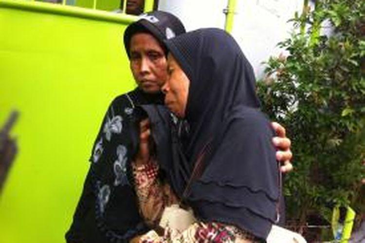 Odeh (52), menantu dari Yanti (26) yang tewas dala kebakaran di Tambora, Jakarta Barat, Jumat (19/12/2014) dini hari.