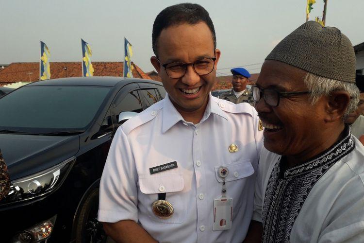 Gubernur DKI Jakarta Anies Baswedan menghadiri acara buka puasa bersama warga Kampung Akuarium di Kampung Akuarium, Penjaringan, Rabu (30/5/2018).