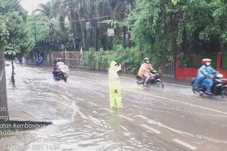 Genangan air di Jalan Srengseng Raya, Kamis (18/2/2021)