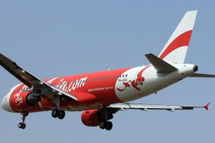 PK-AXC, Airbus A320-200 yang dioperasikan oleh maskapai Indonesia AirAsia, yang hilang sejak Minggu (28/12/2014). Registrasi PK-AXC bisa dilihat di bagian belakang fuselage (badan) pesawat. Foto diambil pada 17 Agustus 2012 di Bandara Soekarno-Hatta, Tangerang, Banten.