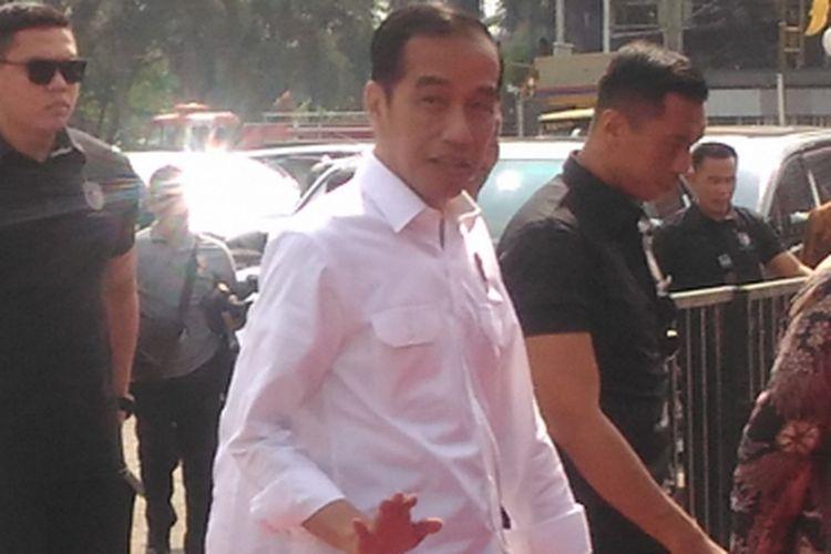 Presiden Joko Widodo saat kunjungan kerja di Palembang, Sumatera Selatan, Jumat (13/7/2018)