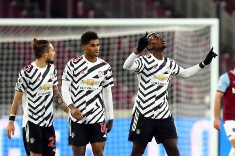 Paul Pogba merayakan gol penyama kedudukan yang memulai comeback Setan Merah atas West Ham United pada lanjutan laga Liga Inggris, Minggu (6/12/2020) dini hari WIB.