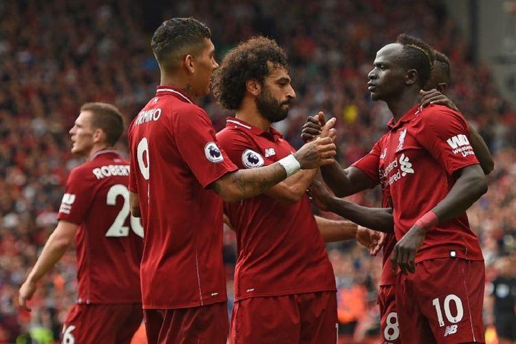 Trio Firmansah - Roberto Firmino, Sadio Mane, dan Mohamed Salah - merayakan gol Liverpool ke gawang West Ham pada pertandingan Liga Inggris di Anfield, 12 Juni 2018.