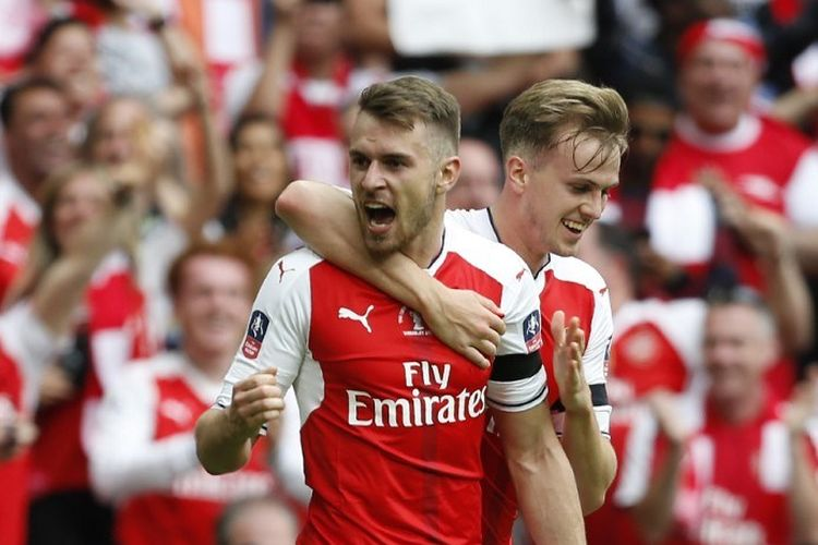 Pemain Arsenal, Aaron Ramsey, merayakan gol ke gawang Chelsea pada laga final Piala FA di Stadion Wembley, 27 Mei 2017.