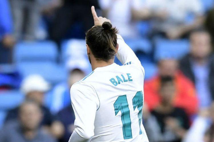 Pemain Real Madrid, Gareth Bale, merayakan golnya ke gawang Leganes pada laga pekan ke-35 Liga Spanyol di Stadion Santiago Bernabeu, Madrid, Spanyol, Sabtu (28/4/2018)