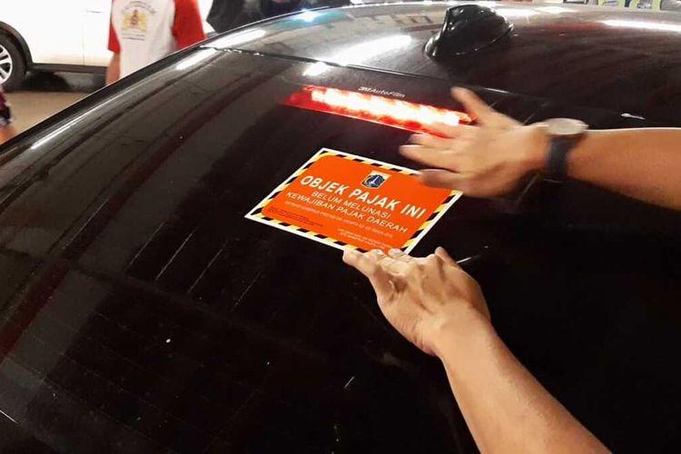 Razia mobil penunggak pajak di PIK Avenue pada Sabtu (14/12/2019) malam