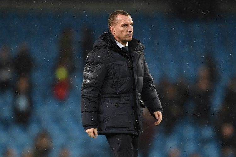 Leicester Citys Northern Irish manager Brendan Rodgers reacts to their defeat on the pitch after the English Premier League football match between Manchester City and Leicester City at the Etihad Stadium in Manchester, north west England, on December 21, 2019. - Manchester City won the game 3-1. (Photo by Oli SCARFF / AFP) / RESTRICTED TO EDITORIAL USE. No use with unauthorized audio, video, data, fixture lists, club/league logos or live services. Online in-match use limited to 120 images. An additional 40 images may be used in extra time. No video emulation. Social media in-match use limited to 120 images. An additional 40 images may be used in extra time. No use in betting publications, games or single club/league/player publications. /
