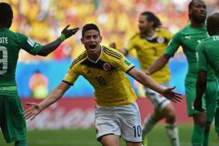 Selebrasi gelandang Kolombia, James Rodriguez, seusai membobol gawang Pantai Gading, Kamis (19/6/2014).