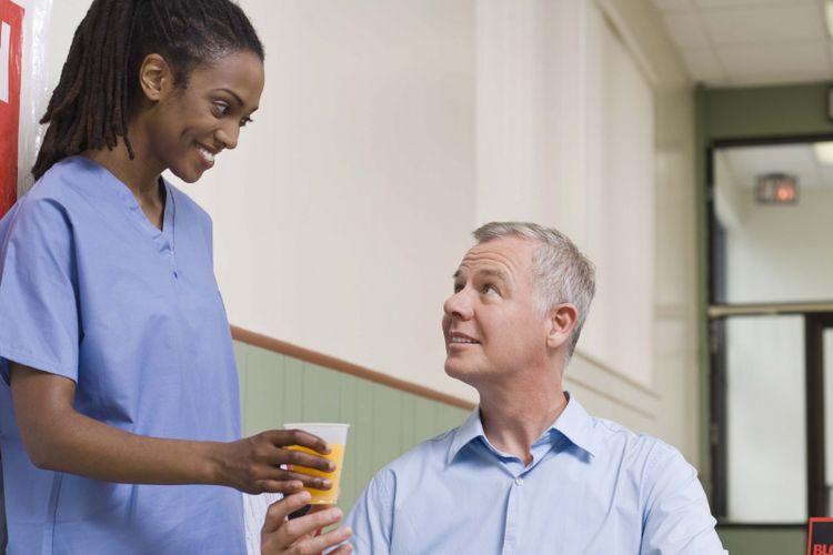 Nurse giving man juice after giving blood