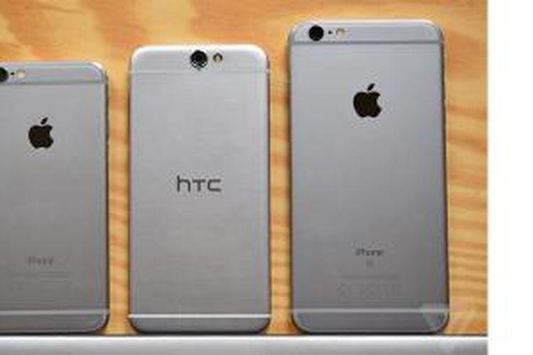 HTC One A9 (tengah) disandingkan dengan iPhone 6s dan iPhone 6s Plus