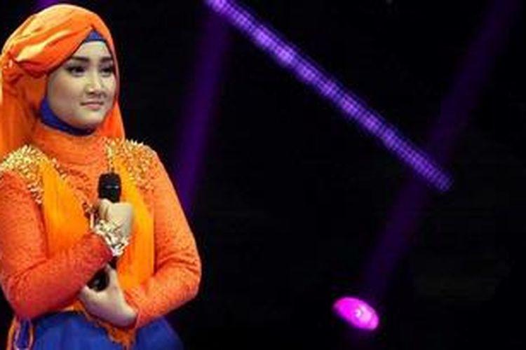 Finalis empat besar X Factor Indonesia, Fatin Shidqia Lubis, tampil pada babak Gala Show (babak eliminasi) ke-11 X Factor Indonesia, yang digelar di Studio 8 RCTI, Kebon Jeruk, Jakarta Barat, Jumat (3/5/2013) malam.