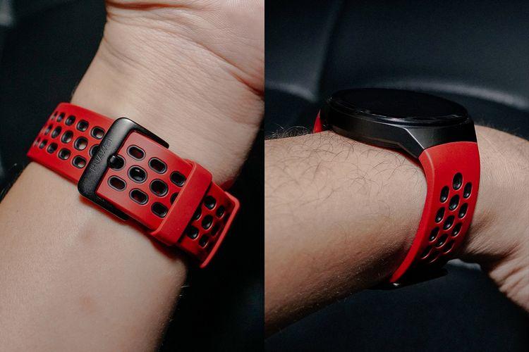 Strap Watch GT 2e varian Lava Red yang berlubang-lubang (kiri) agar lebih nyaman dikenakan saat berkeringat. Tali jam tersambung langsung ke bagian watch case yang berbentuk melengkung.