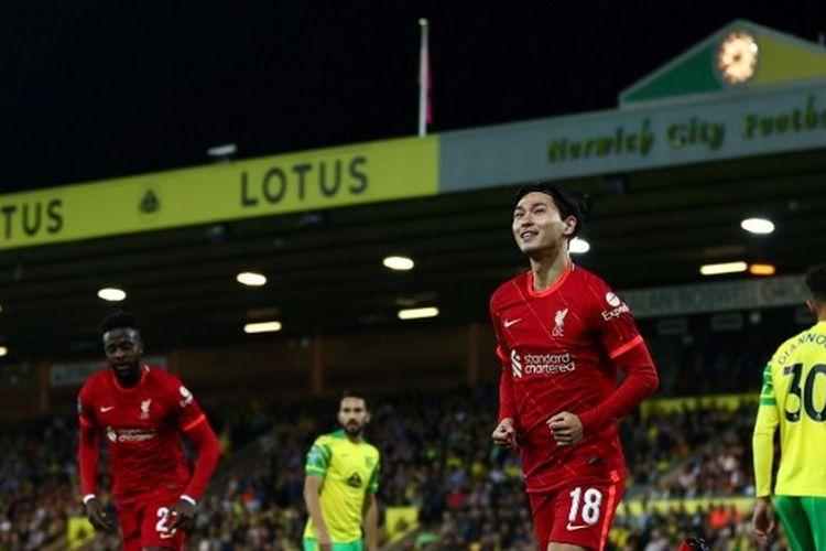 Pemain Liverpool, Takumi Minamino, merayakan gol saat melawan Norwich City pada putaran ketiga Piala Liga Inggris di Carrow Road, Rabu (22/9/2021) dini hari WIB.