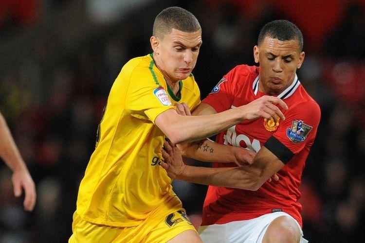 Ravel Morrison beraksi bagi Manchester United pada 2011.