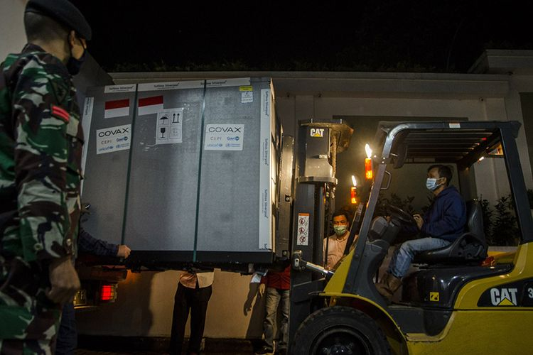 Employees unload an envirotainer containing AstraZeneca's Covid-19 vaccine upon arrival at Bio Farma, Bandung, West Java, Monday, March 8, 2021.
