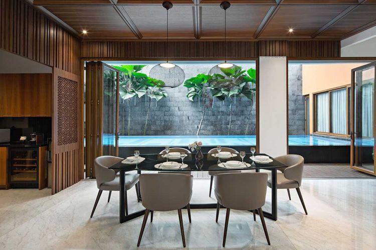 Desain ruang makan eklektik kontemporer karya Vindo Design