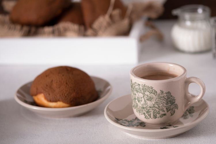 Illustration of coffee bread stuffed with butter and a cup of kopitiam style coffee.