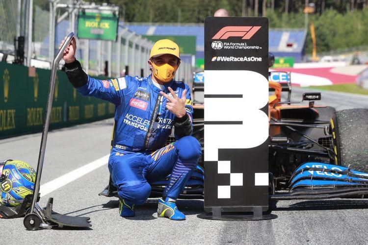 Lando Norris saat berhasil naik podium di GP Austria, Minggu (5/7/2020)