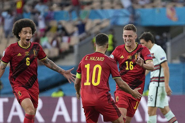 Pemain Belgia Thorgan Hazard (16) merayakan golnya ke gawang Portugal pada laga 16 besar Euro 2020 di Stadion La Cartuja, Sevilla, Senin (28/6/2021) dini hari WIB.