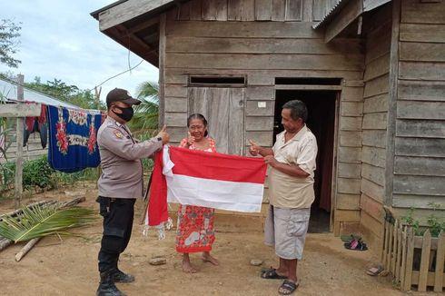 Semangat HUT Ke-75 RI, Bendera Merah Putih Dibagikan ke Warga Suku Talang Mamak Riau
