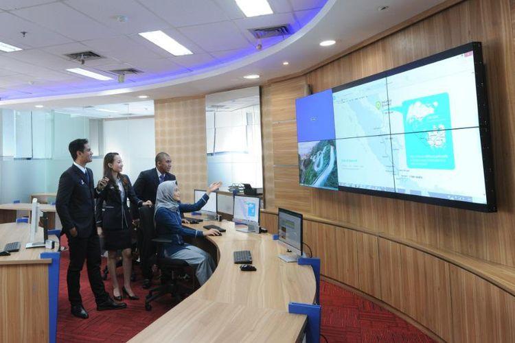 Ilustrasi pegawai PGN yang memanfaatkan sistem digital.