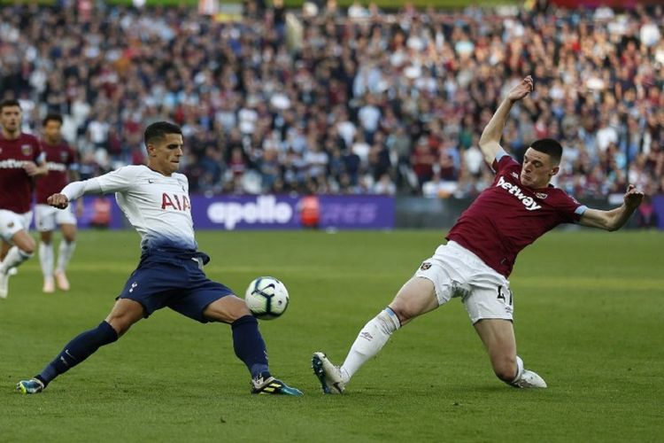 Declan Rice mencoba menahan tendangan Erik Lamela pada laga West Ham United vs Tottenham Hotspur di Stadion London pada lanjutan Premier League, 20 Oktober 2018.