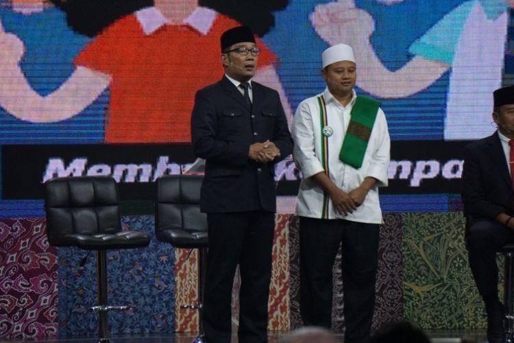 Pasangan calon Ridwan Kamil-Uu Ruzhanul Ulum dalam debat publik Pilgub Jabar terakhir, Jumat (22/6/2018).