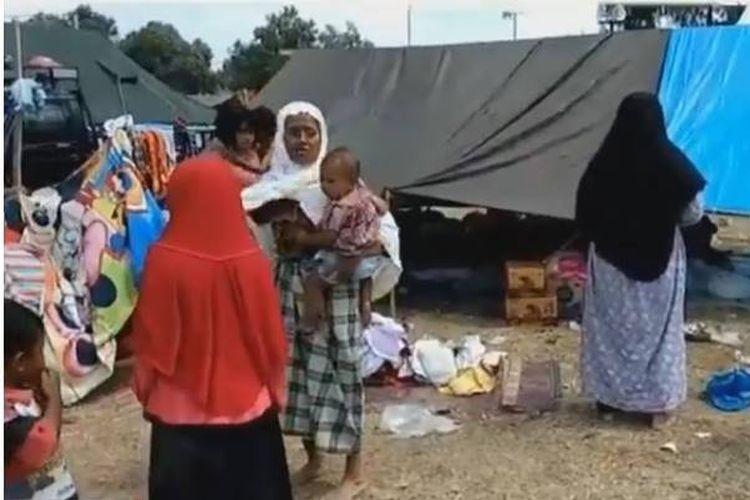 Gempa susulan yang kembali mengguncang Nusa Tenggara Barat, Kamis (9/8/2018) sekitar pukul 13.25 Wita, menimbulkan kepanikan warga di Lombok Utara, NTB.