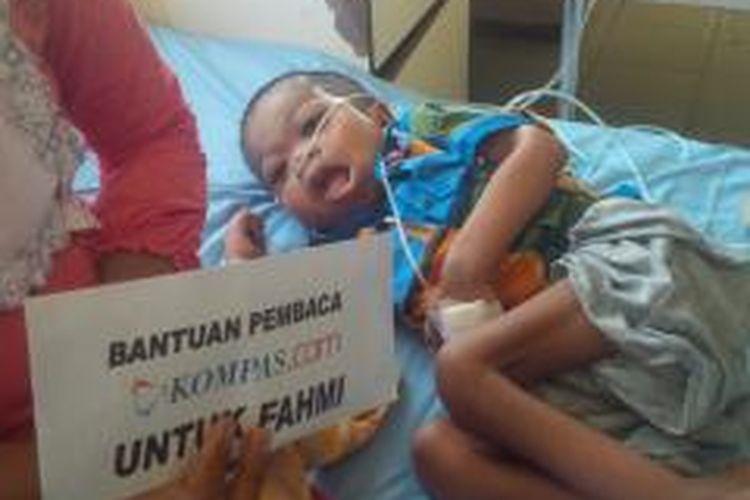 Fahmi setelah dirawat di rumah sakit dr. Slamet Martodirjo. Pembaca Kompas.com, membantu meringankan beban biaya selama perawatan di rumah sakit.