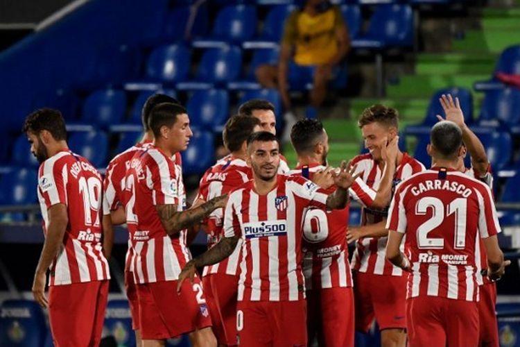 Skuad Atletico Madrid saat merayakan gol ke gawang Getafe pada lanjutan pekan ke-37 La Liga Spanyol, Jumat (17/7/2020) dini hari WIB.