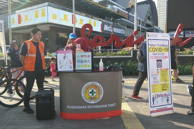 Pemerintah Provinsi (Pemprov) DKI Jakarta mensosialisasikan cara pencegahan penyebaran virus corona pada Hari Bebas Kendaraan Bermotor (HBKB) ataucar free day(CFD) di sepanjang jalur Sudirman-Thamrin, Minggu (8/3/2020).