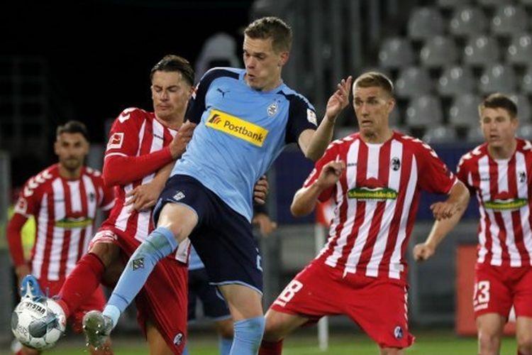 Laga pembuka pekan ke-30 Bundesliga antara Freiburg dan Borussia Moenchengladbach, Sabtu (6/6/2020) dini hari WIB.
