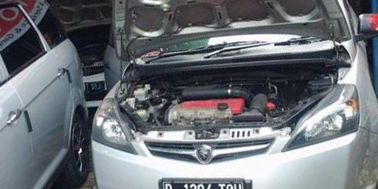 Mobil Proton Exora sedang melakukan pengecekan berkala