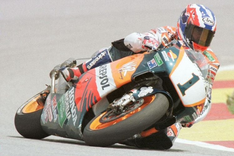Pebalap legendaris Mick Doohan. (Photo by FRANCIS SILVAN / AFP)