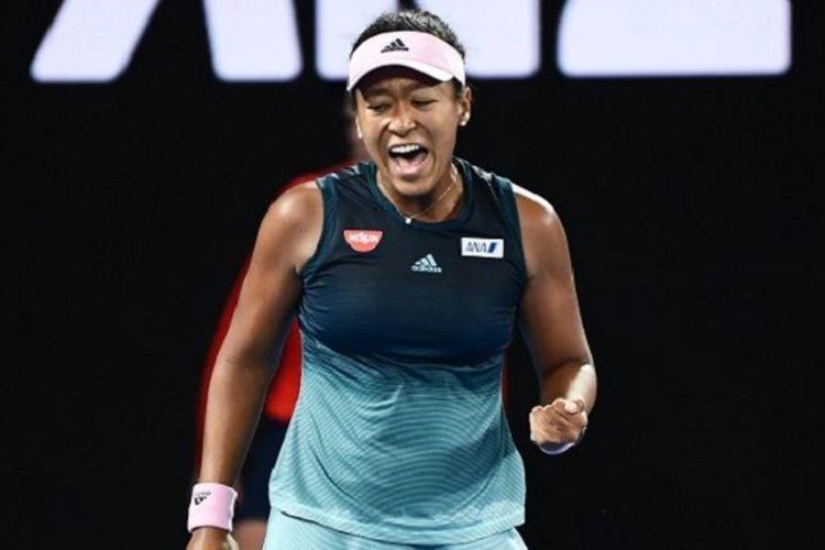 Petenis Jepang, Naomi Osaka, berselebrasi setelah mengalahkan Petra Kvitova (Ceko) pada laga final Australian Open 2019, Sabtu (26/1/2019).