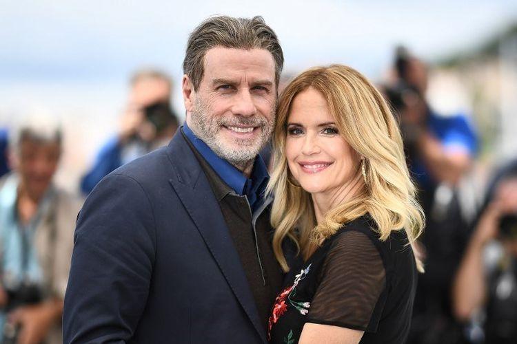 Pada foto yang diambil pada 15 Mei 2018, aktor John Travolta dan istri, aktris Kelly Preston berpose bersama pada pemutaran film Gotti di Festival Film Cannes, Perancis. Kelly Preston meninggal dunia setelah melawan kanker payudara.