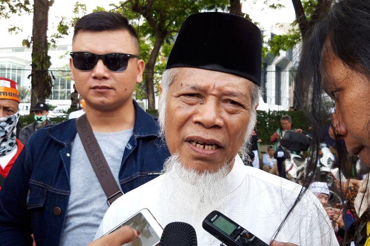 Mantan Penasehat KPK Abdullah Hehamahua sesuai aksi massa di Patung Kuda, Jakarta Pusat, Selasa (18/6/2019)