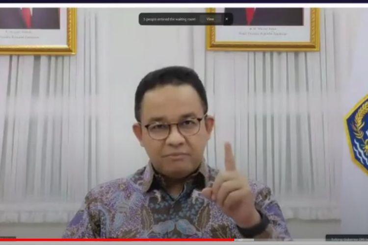 Gubernur DKI Jakarta Anies Baswedan mengacungkan jari telunjuk saat webinar acara Badan Pemeriksa Keuangan RI, Kamis (17/6/2021).