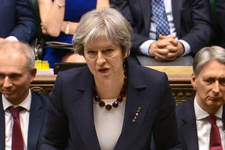 Perdana Menteri Inggris Theresa May ketika berbicara di depan Parlemen Inggris Rabu (14/3/2018).