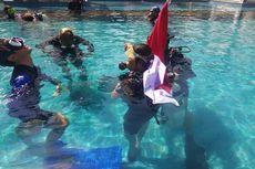 Penyandang Disabilitas Kibarkan Bendera Merah Putih di Dalam Laut