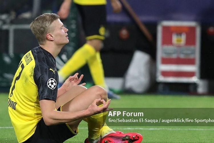 Erling Haaland melakukan selebrasi seusai mencetak gol pada pertandingan Borussia Dortmund vs Paris Saint-Germain di Signal Iduna Park, 18 Februari 2020.