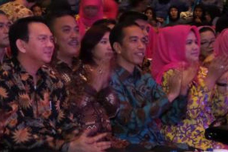 Gubernur dan Wakil DKI Jakarta Joko Widodo dan Basuki Tjahaja Purnama bersama Ketua DPRD DKI Jakarta Prasetio Edi Marsudi saat acara silaturahmi dengan PNS Pemprov DKI Jakarta di Istora Senayan.