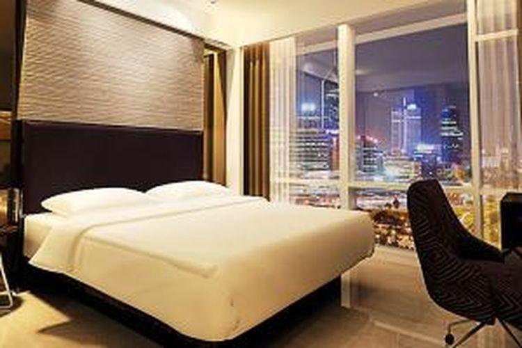 Kamar tipe deluxe Hotel Santika Premiere Hayam Wuruk Jakarta.