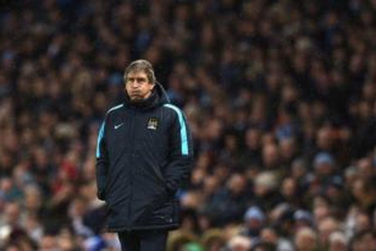 Salah satu ekspresi yang diperlihatkan Manajer Manchester City, Manuel Pellegrini, pada laga Premier League kontra Southampton di Stadion Etihad, Sabtu (28/11/2015).